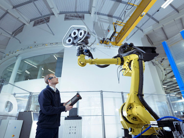 engineer testing artificial intelligence in a lab setting