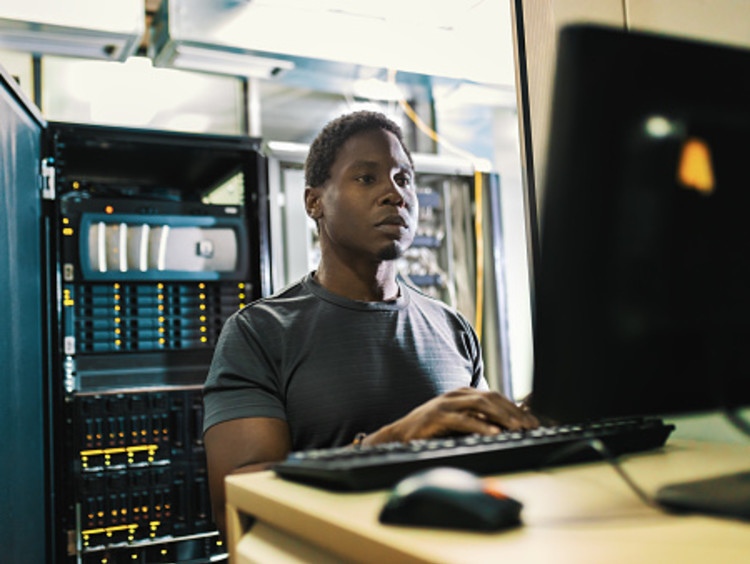 male data analyst working in computer lab