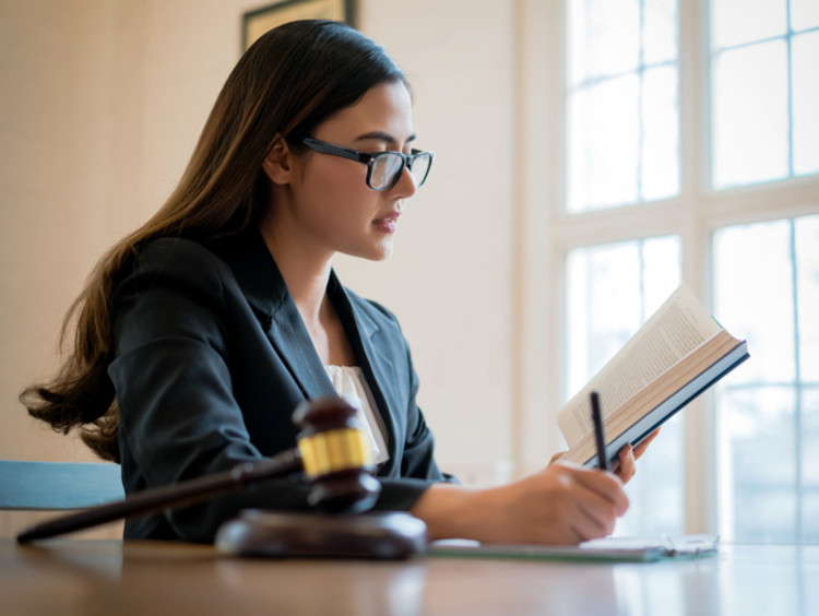 female judge studying court cases