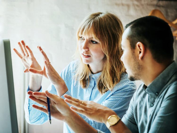 communication specialists problem solving together in an office