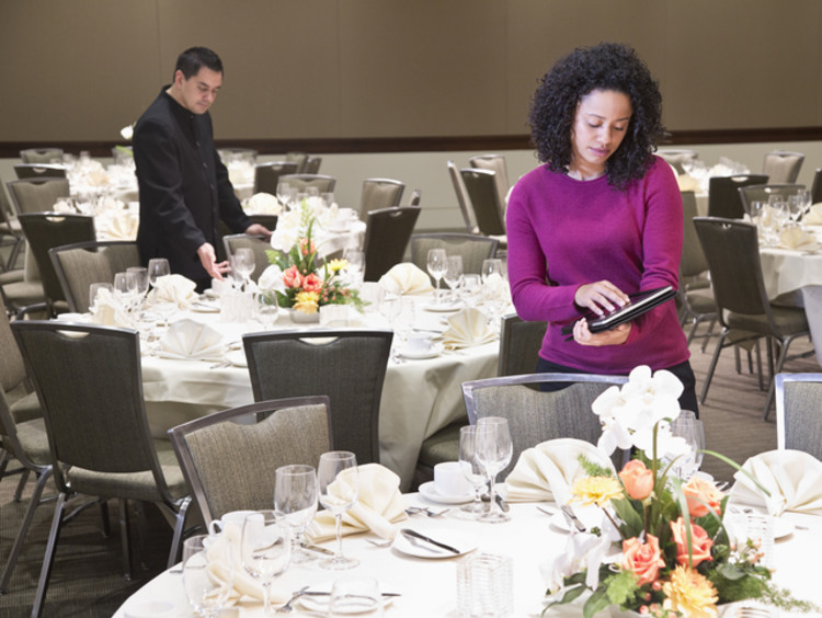 Event planner sets up a wedding in banquet hall