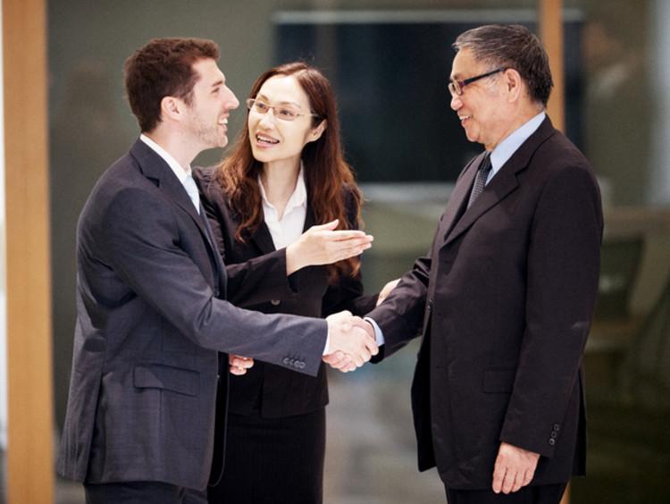 woman translator introducing two businessmen