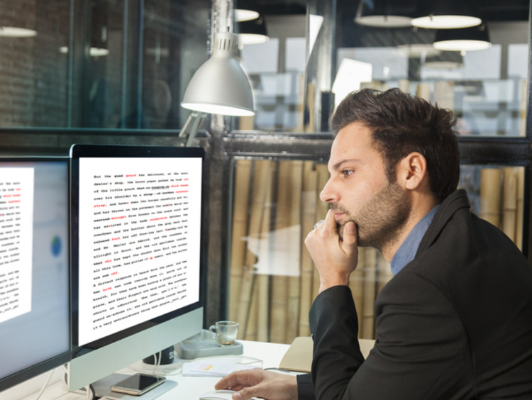 copy editor working in office reading online