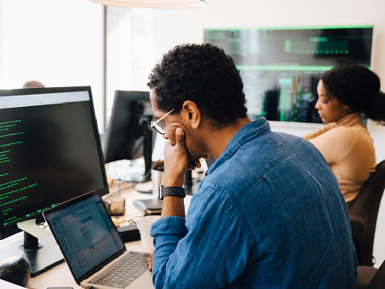 Computer programmer analyzes a piece of code