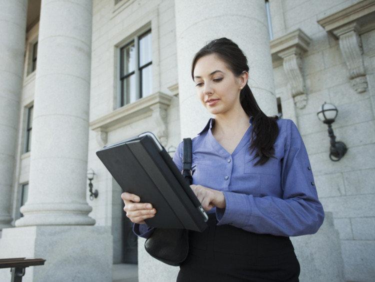 Master's in criminal justice degree student in front of court house