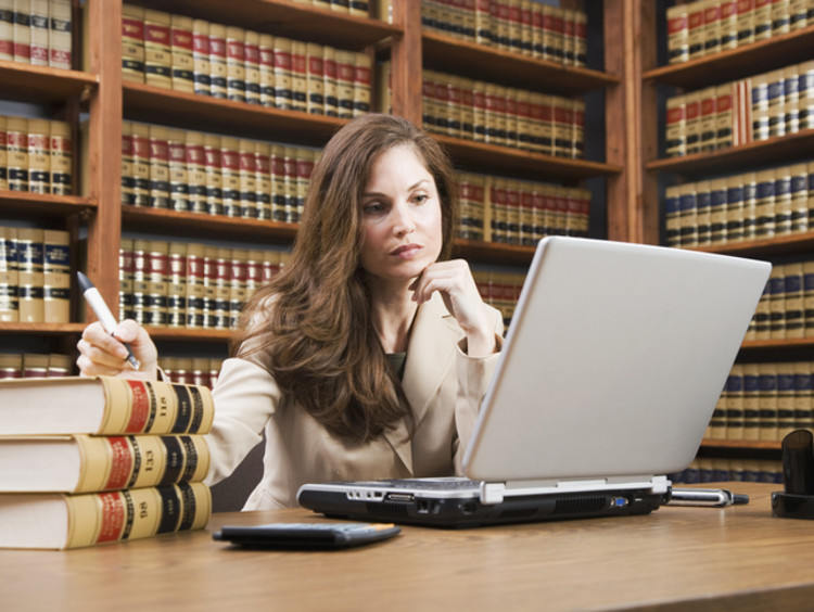 female paralegal working in library