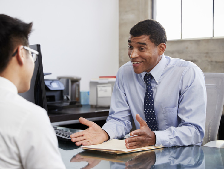 Counselor talks with patient in his office