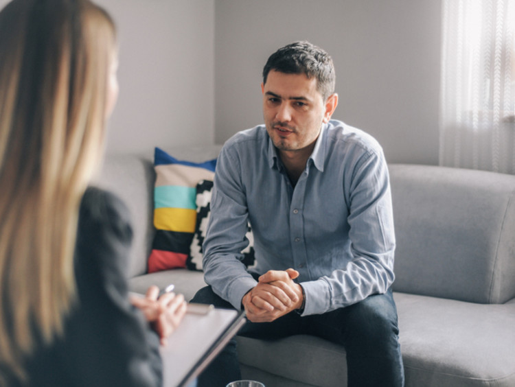 female mental health counselor meeting with male client