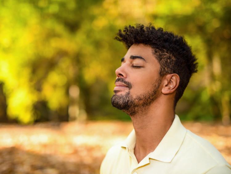 A man meditating outdoors