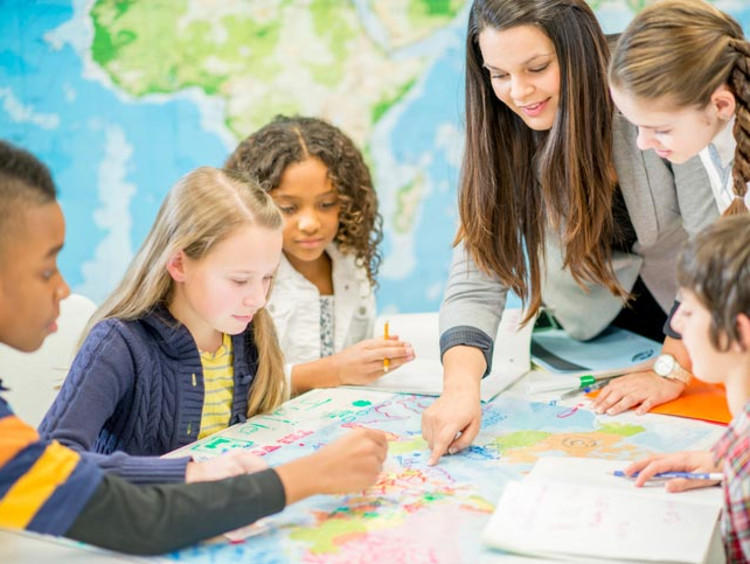 Woman teaching students geography