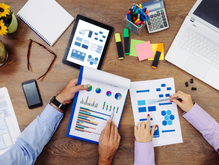 Team of accountants work on a financial report
