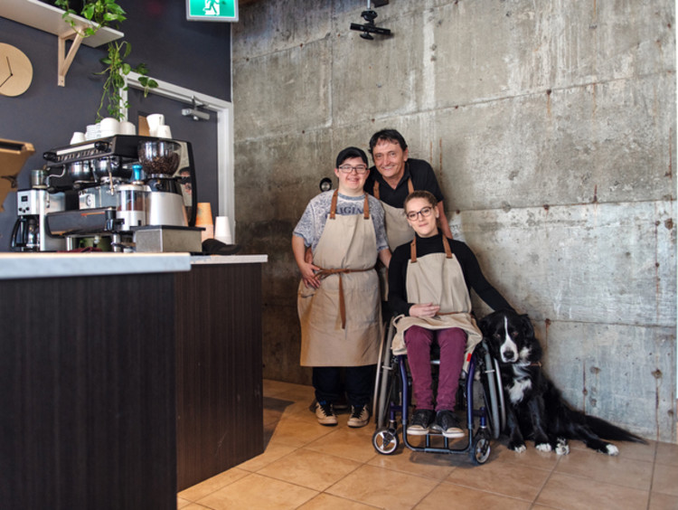 Three employees at coffee shop with conscious company culture
