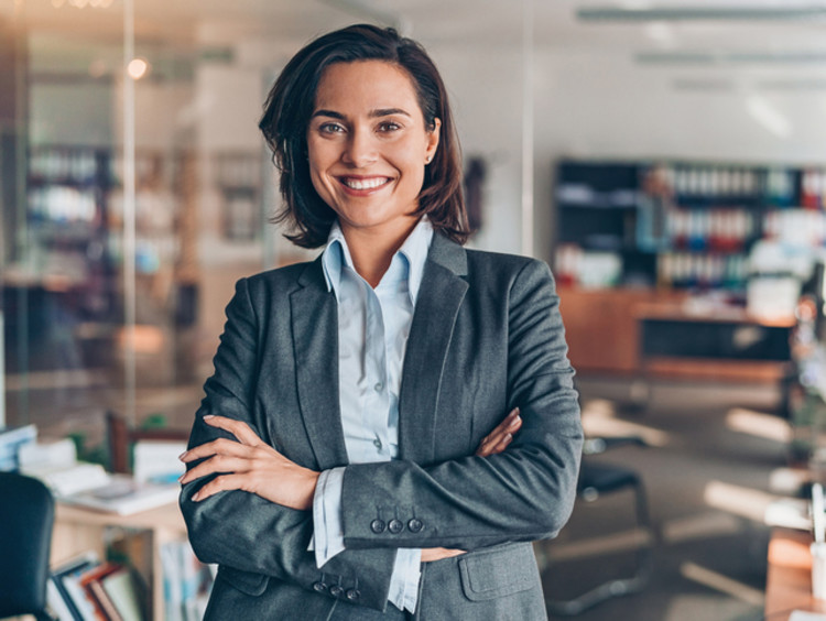Marketing manager smiles in open office