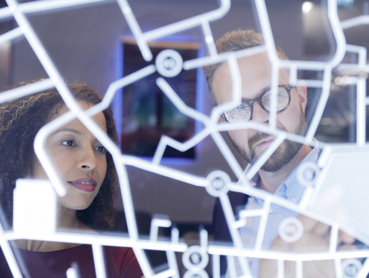 Professionals looking at futuristic display