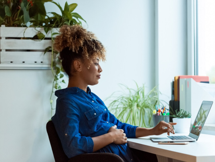 Social media manager working on computer in office