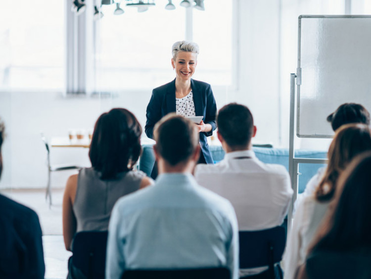 business leader talking to a group of people
