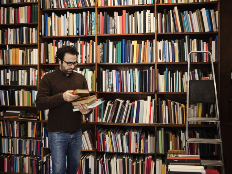 Doctoral student reading book in library