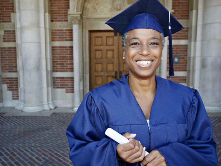 Adult female graduating with her EdD degree