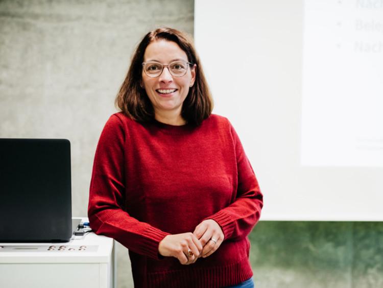 Portrait of a female college professor in her classroom