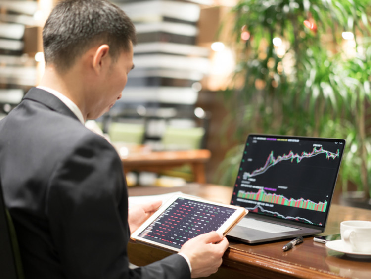 Business professional reviewing quantitative research at desk