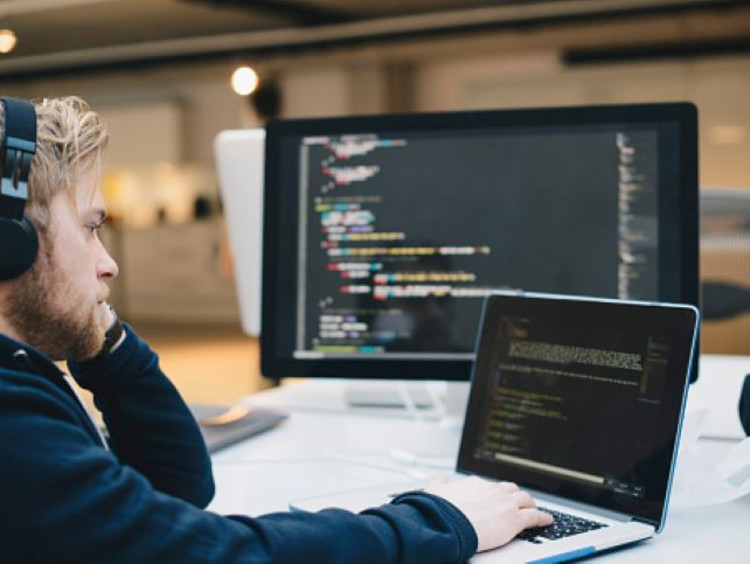 Cybersecurity professional analyzes pieces of code