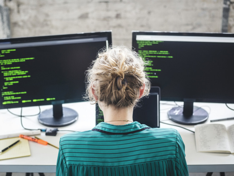 Cybersecurity student looking at coding