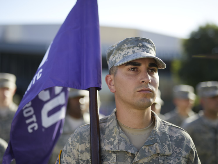 Man holding purple flag
