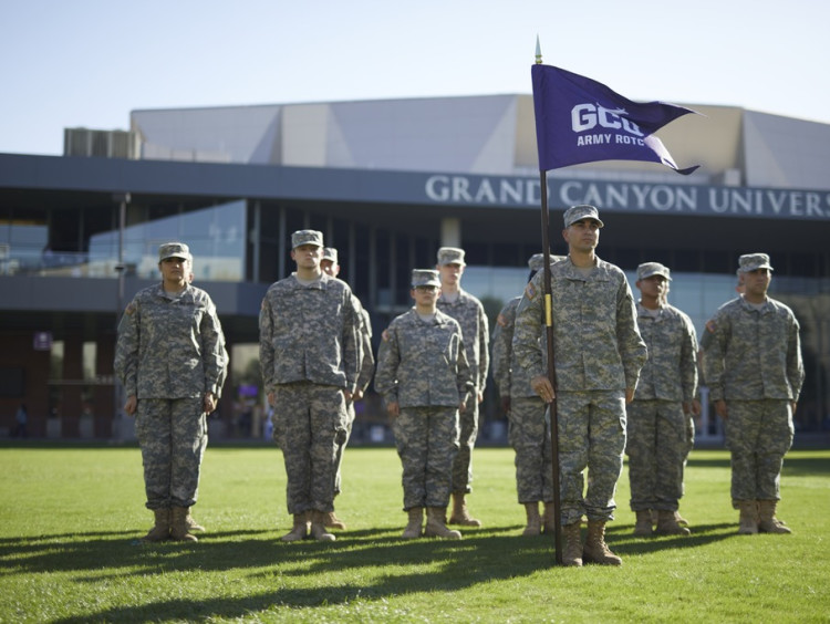 army students standing in front of the GCU Arena