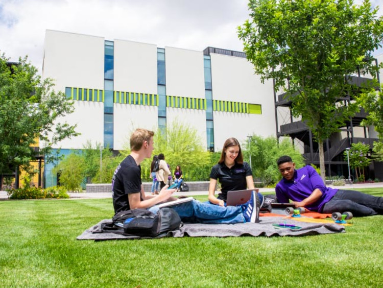 Honors students studying in front of the College of Business