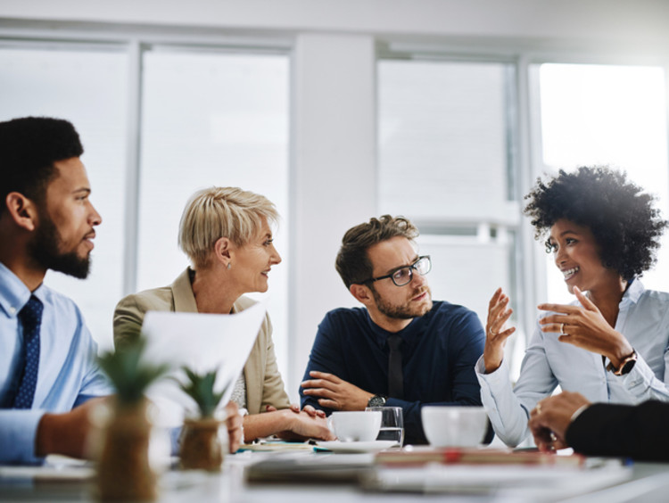 a team of people communicating at work during a meeting