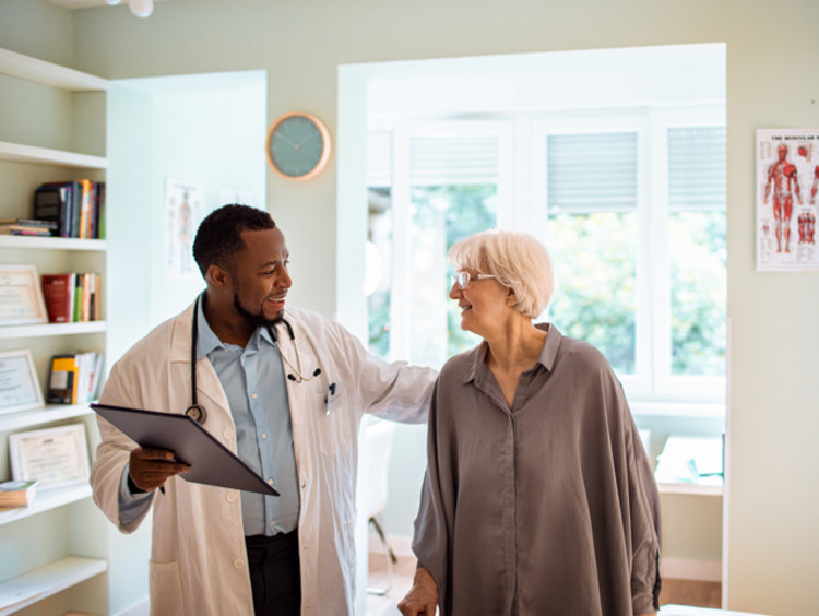 Geriatrician with elderly patient