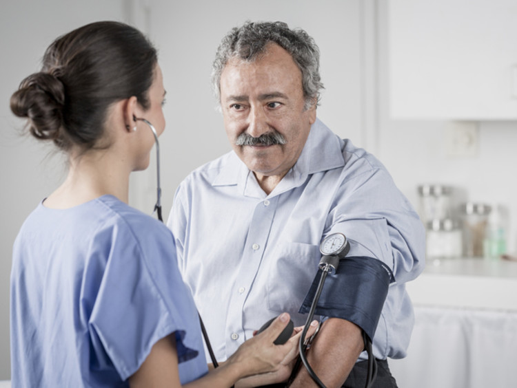 Nurse takes a patient's blood pressure