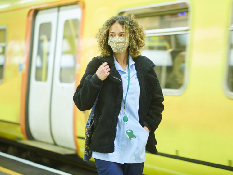 Travel nurse in front of subway
