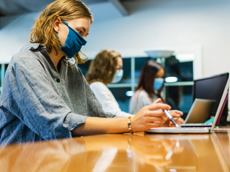 female nursing student studying for NCLEX exam