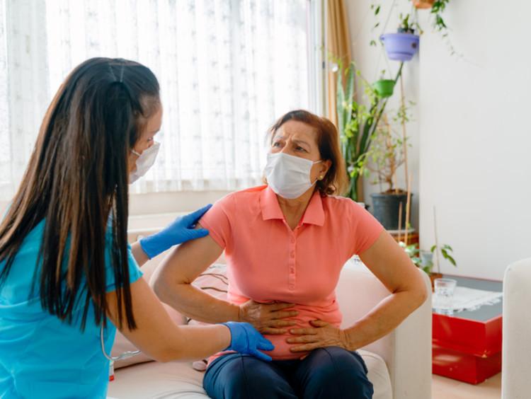 Nurse assisting pancreatic cancer patient