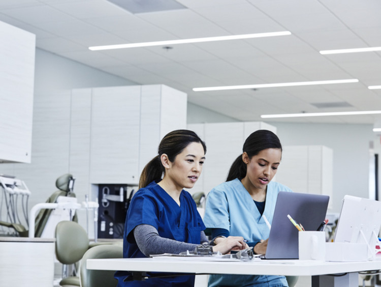two registered nurses working in hospital