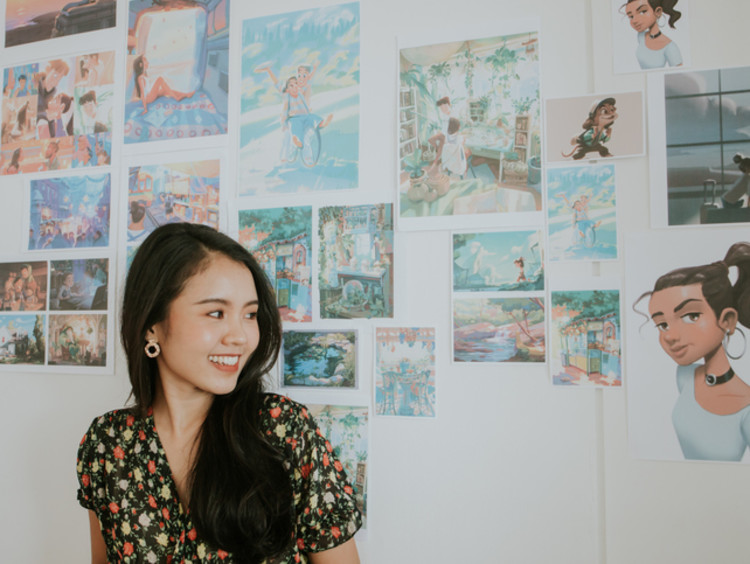 Smiling animation student with artwork