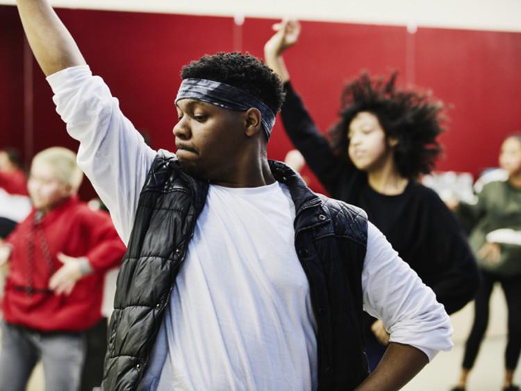 Dance teacher instructing class in studio