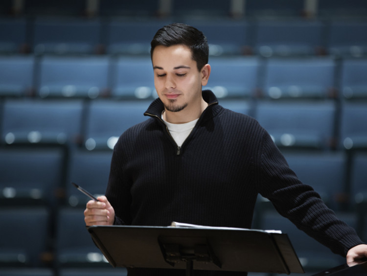 Musical director reading over music