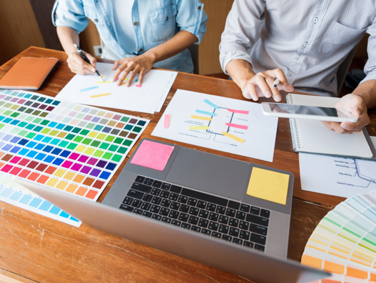 two graphic designers working on a website redesign