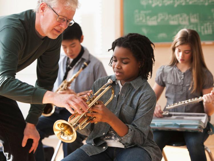 music teacher helping a student