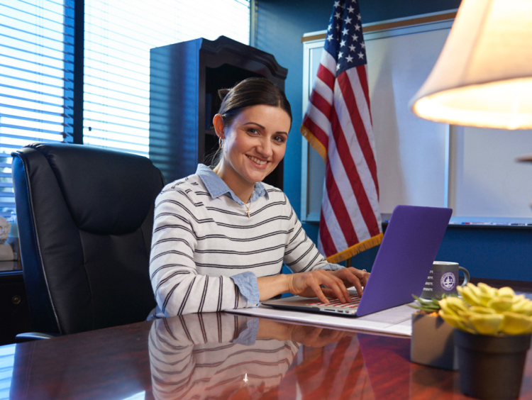 woman principle sits in office space