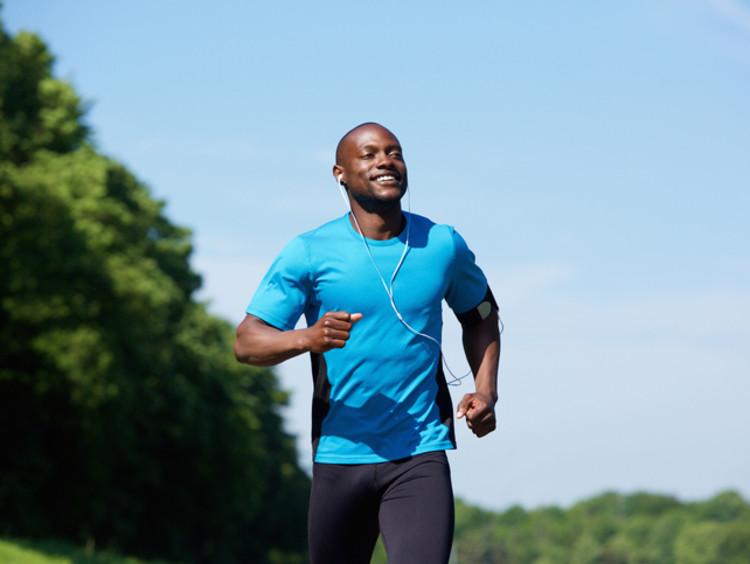 Happy man running in a park