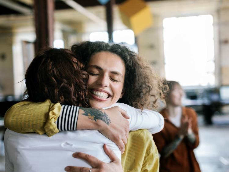 Friends embrace in a warm hug