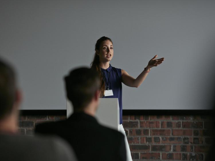 a teacher presenting during a parent teacher conference
