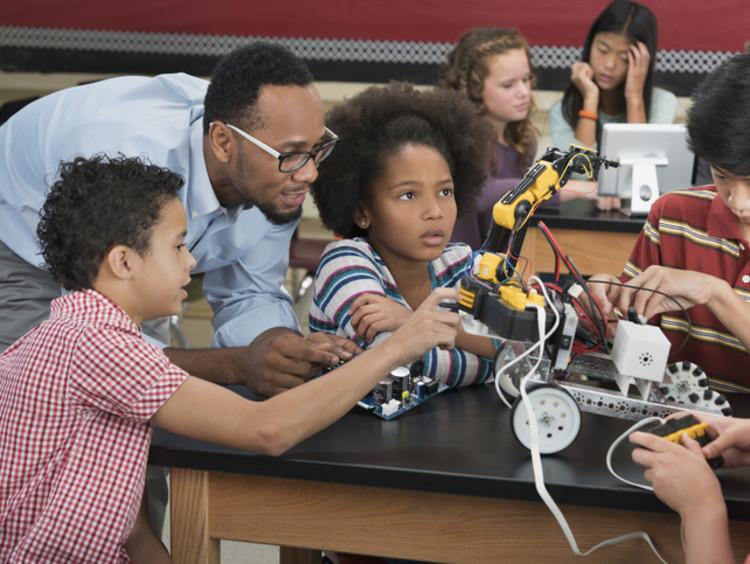 Black STEM educator teaching kids science