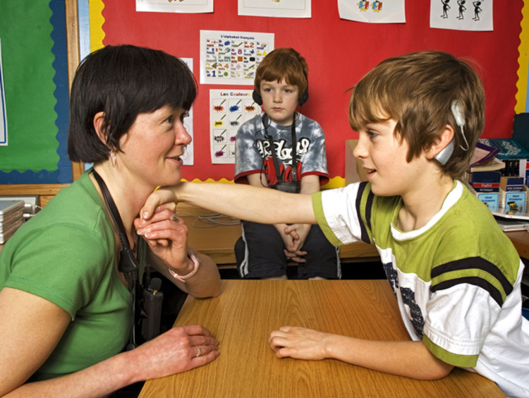 Deaf children learning sign language in the classroom