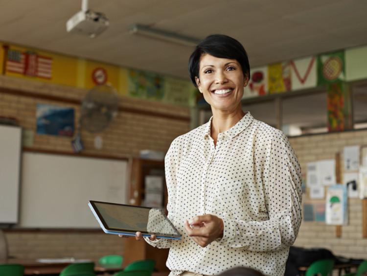 smart female teacher portrait in classroom