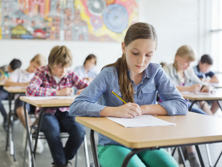 young students taking test in classroom