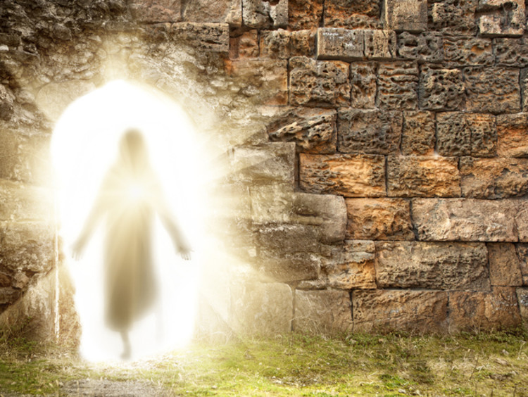 Depiction of the resurrection of Jesus with a bright light in a stone wall